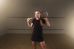 Woman with squash racket, indoor training club Royalty Free Stock Photo