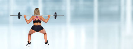 Woman squat barbell. Royalty Free Stock Photography