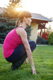 Woman squat outdoor Royalty Free Stock Photo
