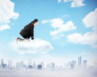 Woman squat on the top of the cloud Royalty Free Stock Photos