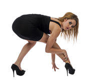 Woman squating down and looking back Stock Photography