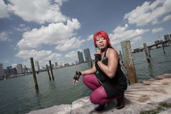 Woman squatting by the bay Royalty Free Stock Photography