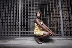 Woman squatting on a dress Stock Photo