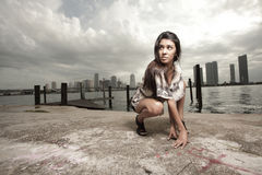 Woman in a squatting position Royalty Free Stock Image