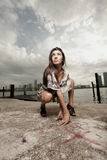 Woman in a squatting position Royalty Free Stock Photography