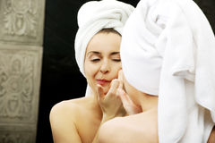 Woman squeeze her acne. Royalty Free Stock Image