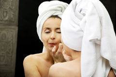 Woman squeeze her acne. Royalty Free Stock Photos