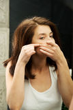 Woman squeeze her acne. Royalty Free Stock Photography