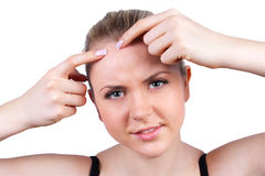 Woman squeeze pimple on white background Stock Images
