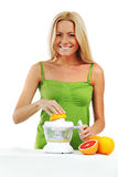 Woman squeezes juice royalty free stock images