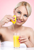 Woman  squeezes the juice from the lemon Stock Images