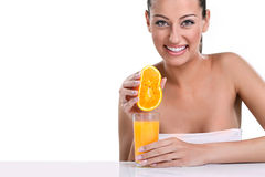 Woman squeezes orange juice Royalty Free Stock Photos