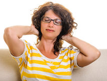 Woman squeezing hair back closed eyes Royalty Free Stock Image