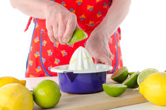 Woman squeezing half a lime Royalty Free Stock Photo