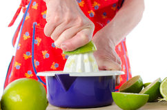 Woman squeezing half a lime Stock Photography