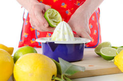 Woman squeezing half a lime Royalty Free Stock Photography