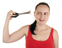 Woman squeezing horn into her own ear Stock Photography