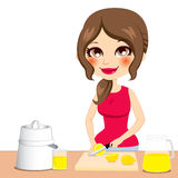 Woman Squeezing Lemons Stock Image