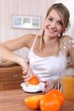 Woman squeezing orange juice Royalty Free Stock Image