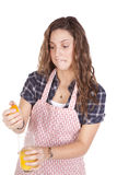 Woman squeezing orange juice hard Royalty Free Stock Photo