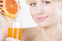Woman squeezing oranges Stock Photography