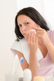 Woman squeezing pimple cleaning acne skin Royalty Free Stock Images