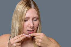 Woman squeezing a pimple on her chin Royalty Free Stock Photo