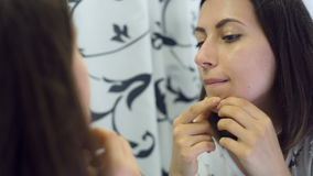 Woman squeezing pimples stock video footage