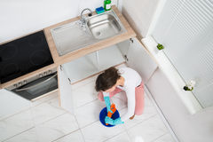 Woman Squeezing Wet Rag At Kitchen Room Royalty Free Stock Image