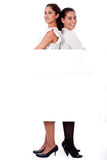 Woman stabding back to back Stock Photo