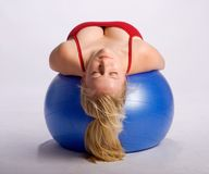 Woman on stability ball Stock Photos