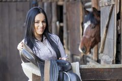 Woman in the stable. Pretty young woman in the stable Royalty Free Stock Photo