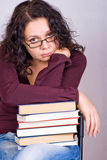 Woman with stack of books Stock Photo