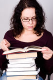 Woman with stack of books Stock Photos