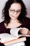 Woman with stack of books Royalty Free Stock Photos