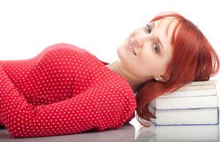 Woman on the stack of books Royalty Free Stock Images