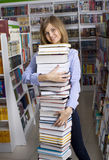 Woman with stack of books Royalty Free Stock Photo