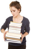 Woman stack of books holding look at Stock Image