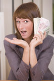 Woman with stack of money Royalty Free Stock Image