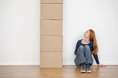 Woman and a Stack of Moving Boxes Royalty Free Stock Images