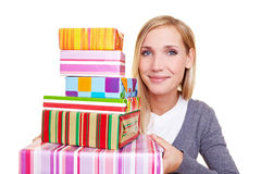 Woman with stack of presents Royalty Free Stock Photo