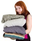 Woman with stack of sweaters Stock Photo
