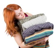 Woman with stack of sweaters Royalty Free Stock Image