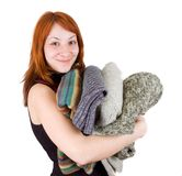 Woman with stack of sweaters Royalty Free Stock Images