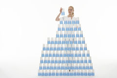 Woman Stacking Plastic Cups Into Pyramid Stock Images