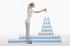 Woman Stacking Plastic Cups Into Pyramid Royalty Free Stock Image