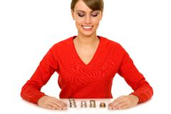 Woman with stacks of coins Royalty Free Stock Photography
