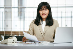 Woman staff in office Stock Images