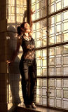 Woman stained window Royalty Free Stock Photos