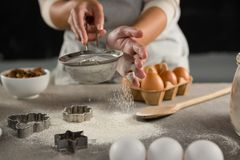 Woman staining flour in sieve Stock Photos
